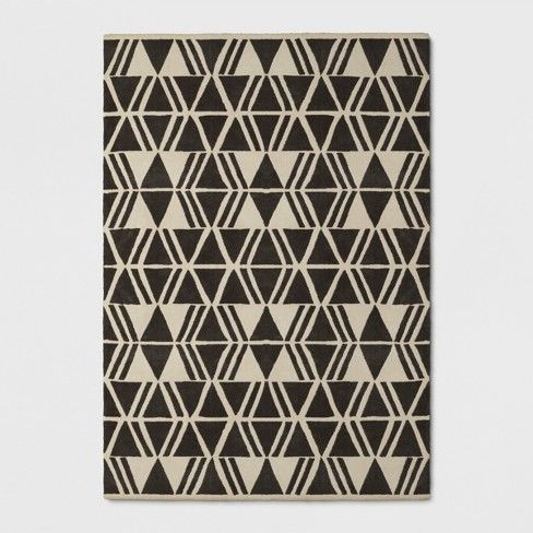 If your room just doesn't feel complete, consider adding an area rug. The Microplush Geo Area Rug from Project 62™ features strong geometric outlines, which are subdued by the neutral color palette. You'll be surprised how well this can fit into any room, adding dimension and warmth. The high pile rug is indulgent to walk on, and an inviting texture to see in what may be an otherwise minimalist modern room.<br><br>1962 was a big year. Modernist design hit its peak...