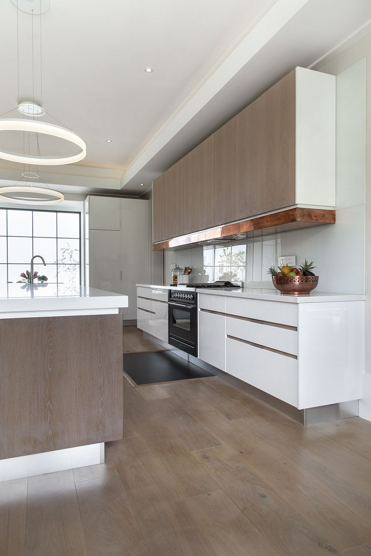 Kitchen trends. Copper accents. Handle-less units. Dark floors. The industrial look. Clutter-free worktops. Clever storage solutions. Kitchen organization. Monochrome tones. Mix old and new.