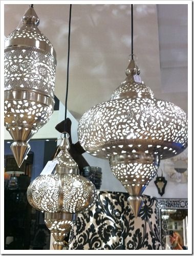 Indonesian-style metal lanterns.  Beautiful hung in a cluster of three.