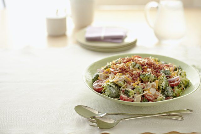 This creamy, tangy chicken salad comes with the crunch of red onions and fresh broccoli florets and a garnish of shredded Cheddar and chopped turkey bacon.