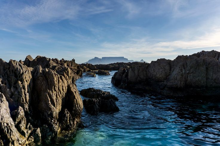 Cape Town's famous Table Mountain visible through the rocks of Blouberg Beach. Photograph by Kirsti Chambers.