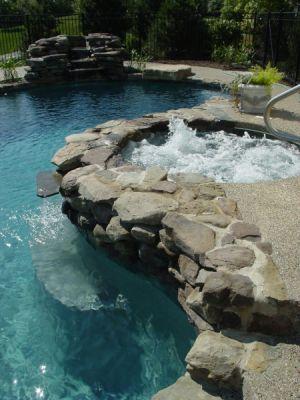 riverstone gives this spa / hot tub a natural pools look #barringtonpools