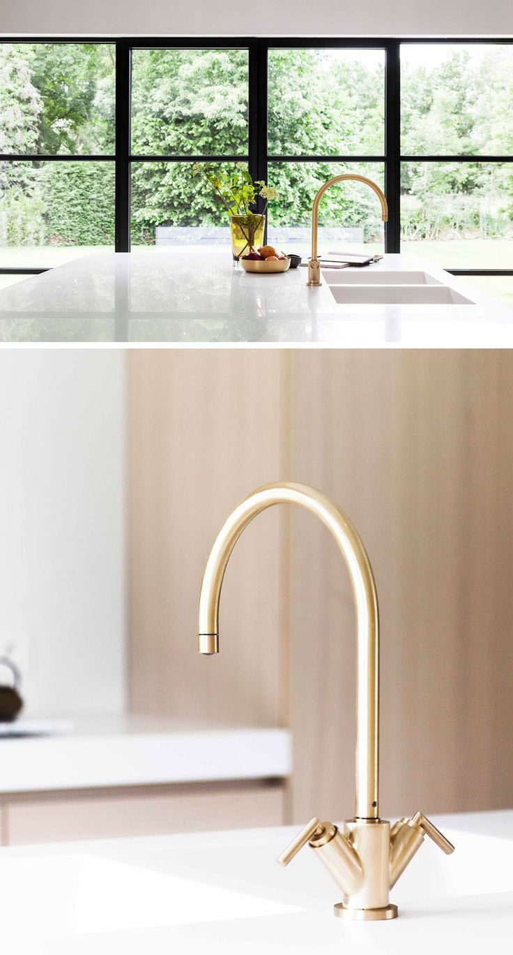 Gold and brass fixtures and faucets promising or passe apartment - In This Modern Light Wood Kitchen There S A Large Centrally Located Kitchen Island That Provides