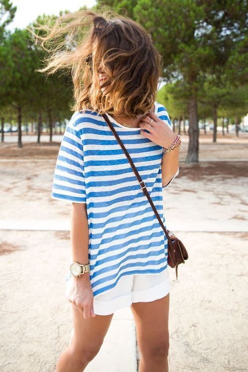 White shorts. Loose striped tee.