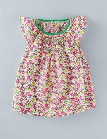 Baby Boden Pretty Smocked Top Multi Flowerbed Girls Boden, As light as dragonfly wings and almost as colourful, our nostalgic smock tops are designed to keep you cool and comfortable on hot holidays. http://www.MightGet.com/january-2017-13/baby-boden-pretty-smocked-top-multi-flowerbed-girls-boden-.asp