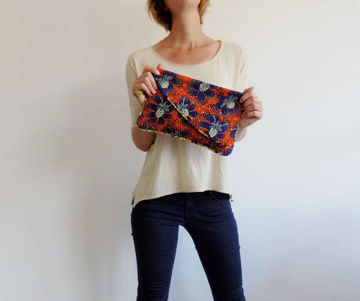 Colorful clutch handmade in Italy, with real wax cotton fabric