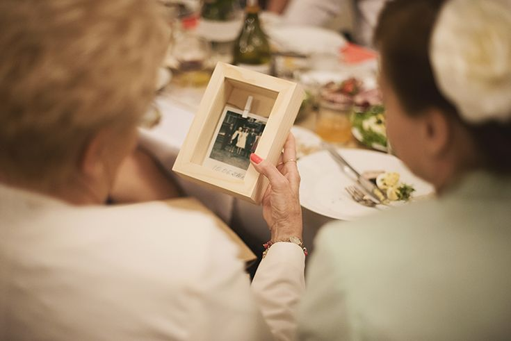 Wooden frames with Polaroid photos for guests  by GRUNT STUDIO
