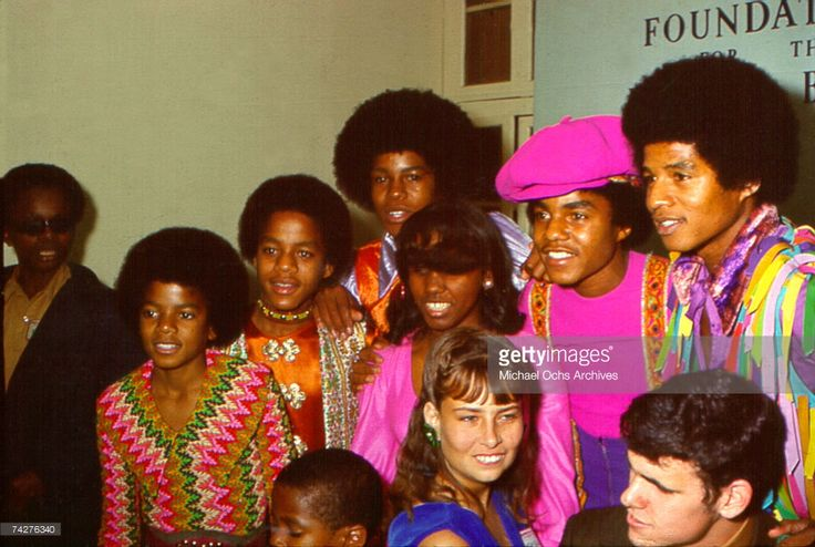 R&B quintet 'Jackson 5' pose for a portrait with fans in circa 1970. (L-R) Michael Jackson, Marlon Jackson, Jermaine Jackson, Tito Jackson, Jackie Jackson.
