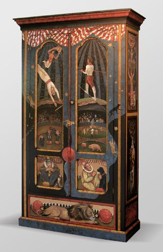Trapeze artists, a tightrobe walker, clowns and dogs decorate this colorful wardrobe