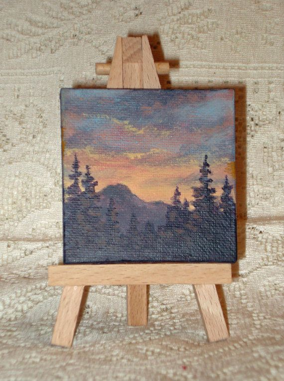 This painting is approximately 2 3/4 x 2 3/4 inches. It is painted with acrylic paint. The sides are painted black. It comes with an easel. This painting is signed by the artist on the bottom edge of the canvas.