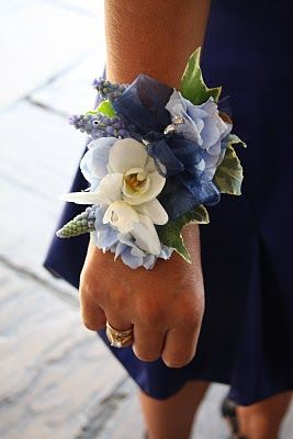 Wrist corsage with muscari, early Spring; very pretty but instead of muscari and orchid replace with freesia and lavendar and white or green hydrangeas