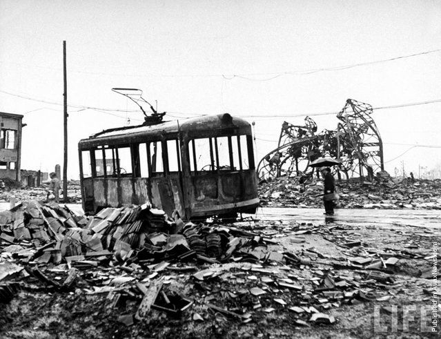 The aftermath of the atom bomb dropped on Hiroshima, Japan, by the Americans at the end of World War II. The occupants of the burned-out bus were all killed. (Photo by Keystone/Getty Images)