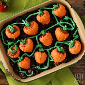 Decorate strawberries to look like pumpkins, then plant them in a patch of chocolate cookie crumbs for a fun and festive Halloween dessert.