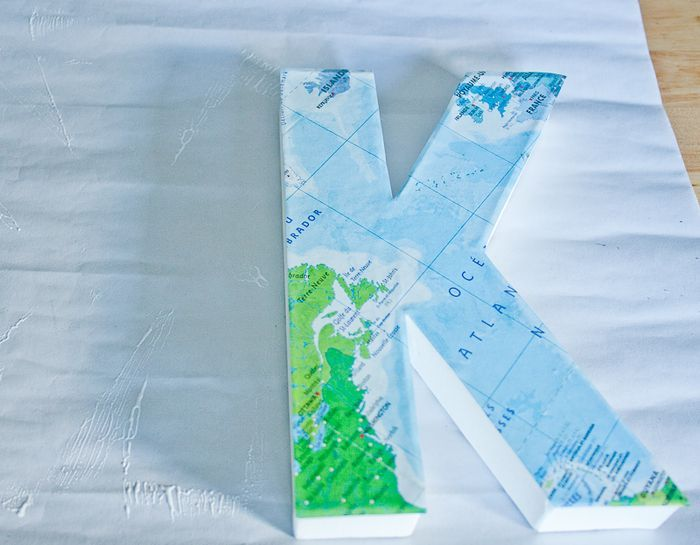 for a beach mantle - the ocean part of a map decoupaged onto a letter from Jo-Anns.