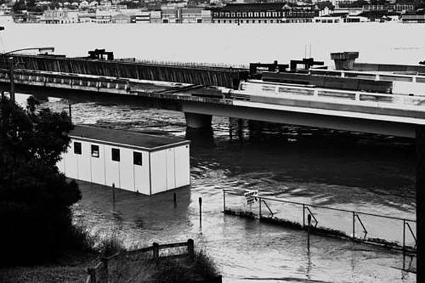 The flooded Riverside Expressway while under construction, with a view of South Brisbane in the background, January 1974. Photo: Copyright State Library of Queensland/Author unknown