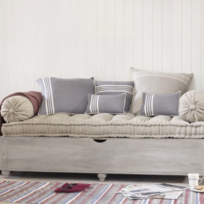 BONJOUR DAYBED This gorgeous daybed was the idea of Cat, our Head of House, as so many people want storage space to squirrel things away. It has a weathered wood finish and comes with the mattress in natural linen which all lift up easily to reveal bags of storage space.