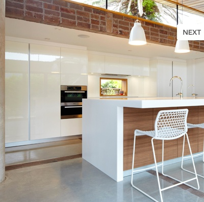 Love this kitchen.  The use of white with timber is fresh but warming.