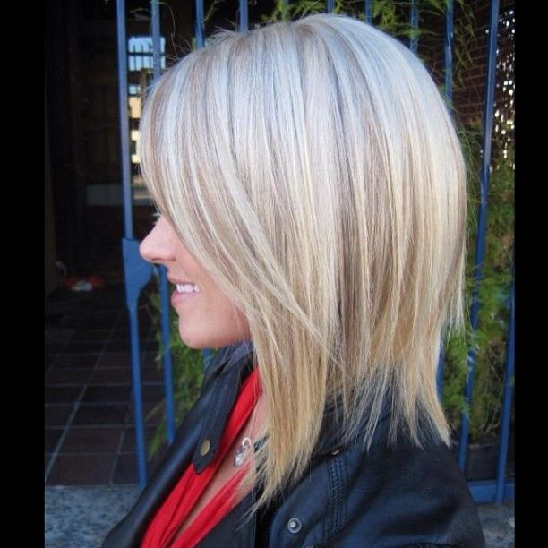 Slightly a-lined long bob and added depth and dimension with lowlights to her platinum blonde hair