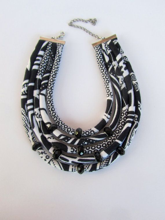 I made this black and white fabric statement necklace from african wax print fabrics which I combined with black European glass beads to add a touch of elegance to this special necklace Definitely a statement necklace to be noticed for your special occasions and ofcourse for those who love the black and white color Length from one end to the other in a straight line is15.5 inches or 44.5 cm (inner circomference). I have also added 3 inches or 8 cm extention chain .Please let me know if you…