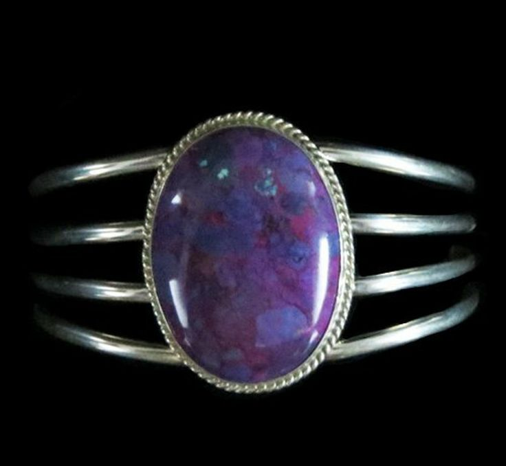 Sterling Silver Cuff in Magenta Turquoise Sterling silver cuff bracelet with one oval Magenta stone on 4 bands of silver http://nativeamericanstuff.net/magenta_turquoise_jewelry.htm