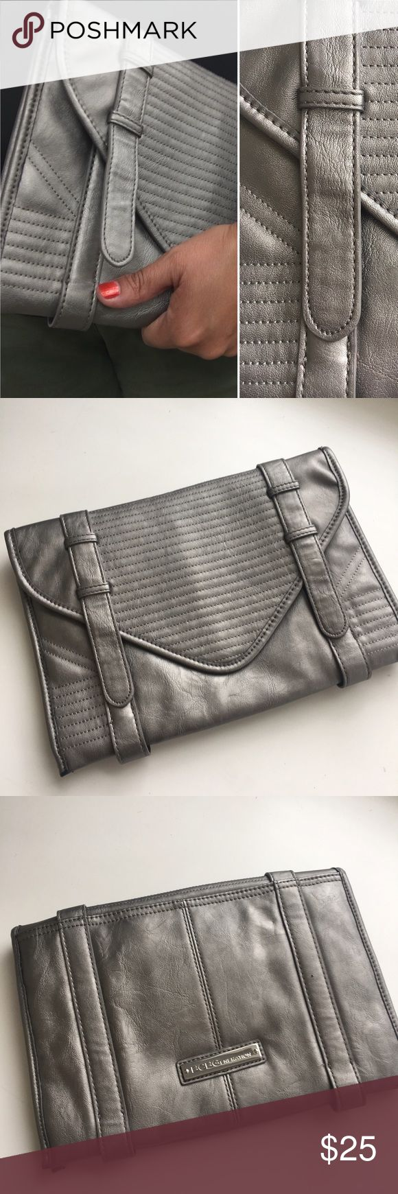 "BCBG Clutch Silvery Leather Clutch has been gently used. 12"" tall by 20"" wide. Cloth interior with pockets. Closure has magnet. BCBGeneration Bags Clutches & Wristlets"