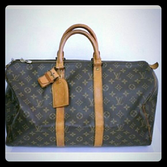 Flash! Auth Louis Vuitton Keepall 45 Handbag LOUIS VUITTON Keepall 45 Made in : France Color : Brown Material : Monogram Canvas / leather Size (inch) : W17.7 x H9.8 x D7.8 (approx.) Serial number : SP0970 Double Zipper Closure, Accessory : Poignees Name Tag This is Louis Vuitton's monogram traveling bag - Keepall 45. Holds a lot of item in the bag.Practical item. This bag has double zipper closure. The tanned leather trim has some discoloration,scuff, marks or wear from being used. If you…
