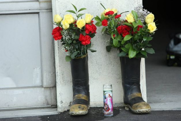 flowers in firefighter boot-My daughter would love this on her deck