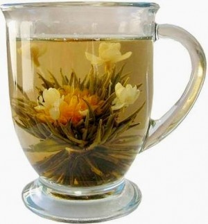 I love flowering teas - so beautiful!  As shown by this example of Jasmine Marigold Tea
