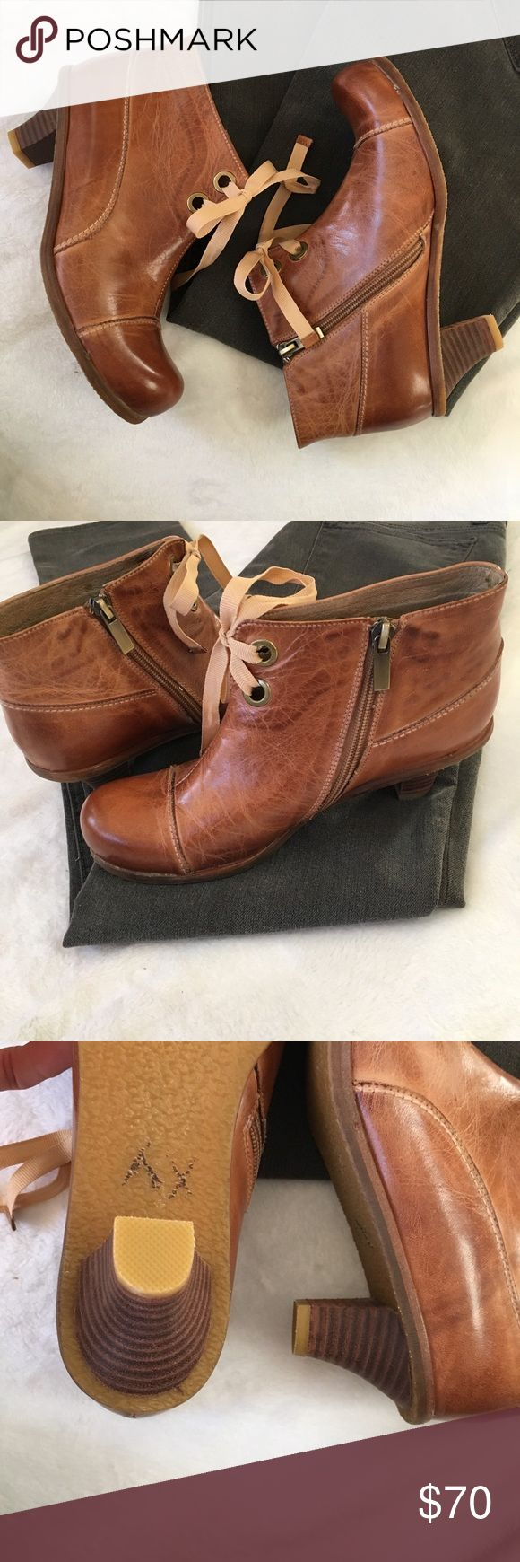 Antelope lace up leather booties in cognac Gorgeous pair of vintage inspired heeled brown leather booties from Antelope. Rounded toe and grommeted ribbon ties give these booties a Victorian feel. Beautiful cognac color leather is smooth and supple. Perf https://bellanblue.com