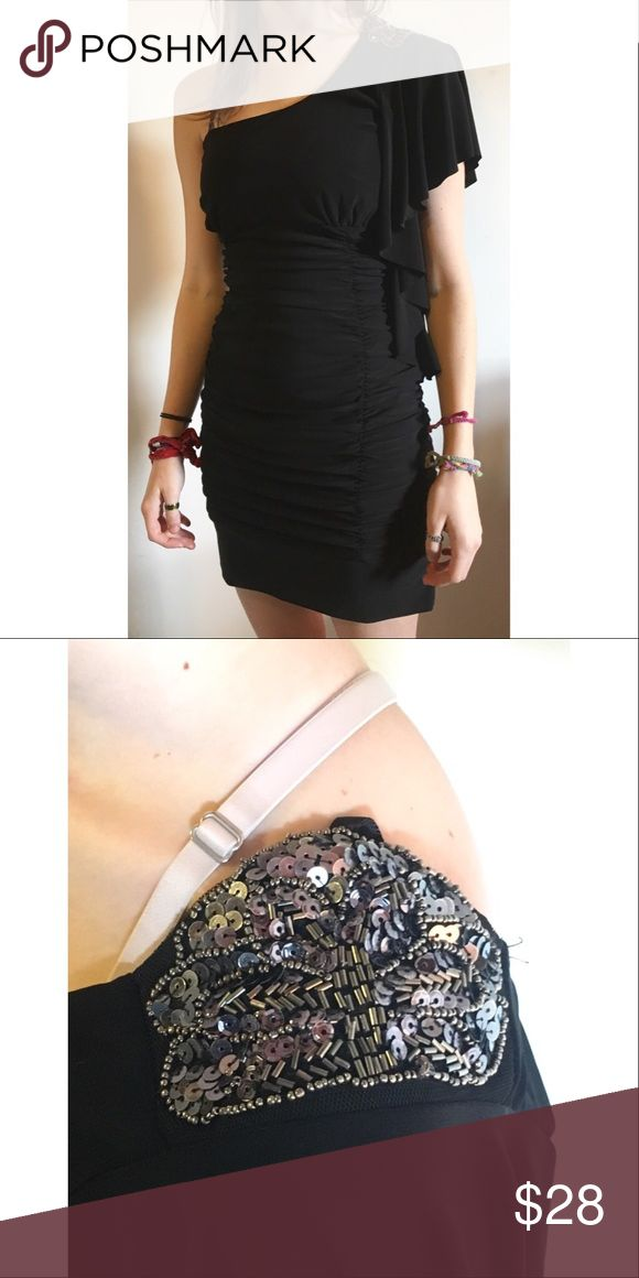 Small Mini Black Taboo Dress ☾ Brand  | Taboo ☾ Size  |  Small ☾ Color  |  Black with gorgeous pewter sequin design on left shoulder ☾ Condition  |  Worn once, still in great condition ☾ Material  |  92% polyester, 8% spandex ☾ Features  |  Mini, pewter design, stretchy  → Measurements      • Bust is 25 inches unstretched      • Waist is 22 inches unstretched      • Hips are 28 inches unstretched      • Length is 32 inches - shoulder to hem                    ✔ 1 to 2 day shipping ✔ Smoke…