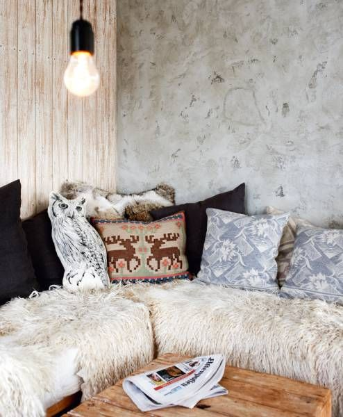 comforting space. sheepskin and eclectic scatter cushions.