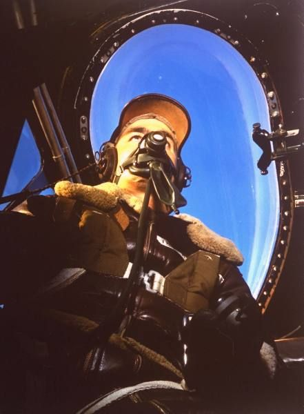 Fortune Color February 1942. Pilot in US mil. leather jacket wearing oxygen mask, sitting in plane cockpit (no caps). | Date: 1942 | Photographer: Dmitri Kessel | LIFE archive - Hosted by Google