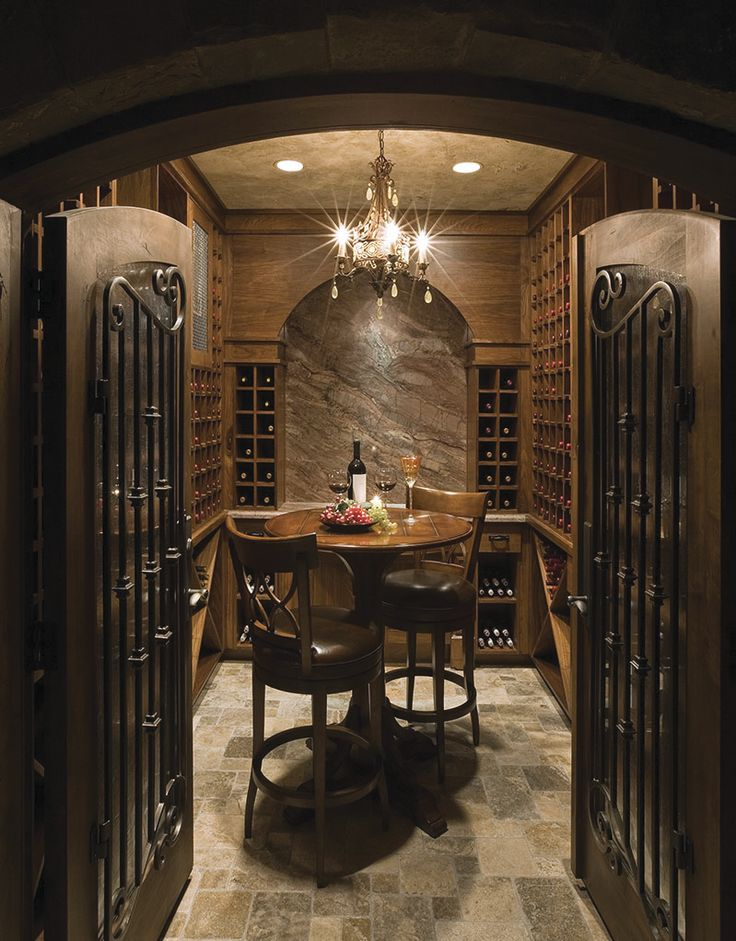 Big Sky Journal - The Ski Dream Home in Park City, Utah, consists of two wine cellars in a 13,000-square-foot mansion with a private ski bridge linking Deer Valley Resort. This intimate tasting room features 10-foot-high ceilings and temperature and lighting settings that are programmed via remote control. Photo: Dan Campbell