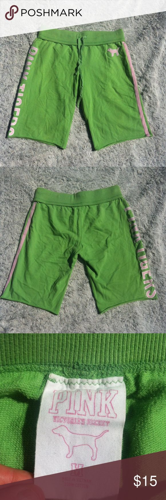 "Victoria's Secret Pink lime green sweat shorts Victoria's Secret lime green sweat shorts-""pink tigers"" written on left side, pink strip down left side. Decal if a pink dog on left side.  Size medium. Inseam 13"". PINK Victoria's Secret Shorts"
