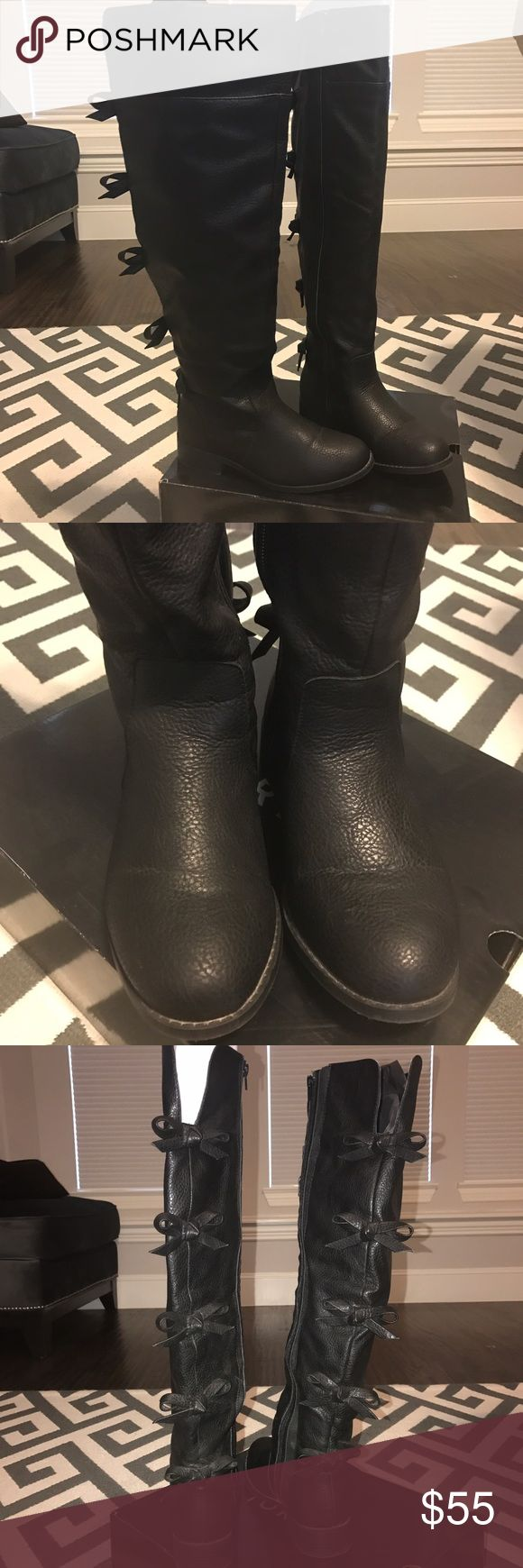 Torrid Knee High Back Bow Boots Great condition! Super cute, wide width, wide calf. I usually wear between 7.5-8 & these fit great. torrid Shoes Over the Knee Boots