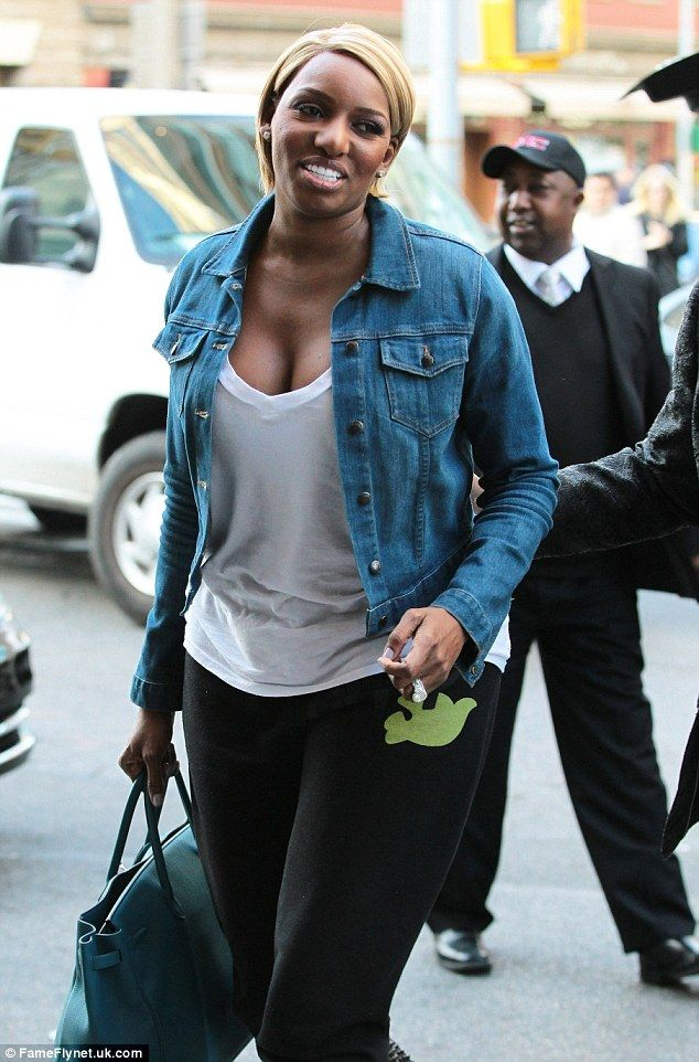 Glowing: The mother-of-two also went for the natural look the day before as she arrived in the Big Apple