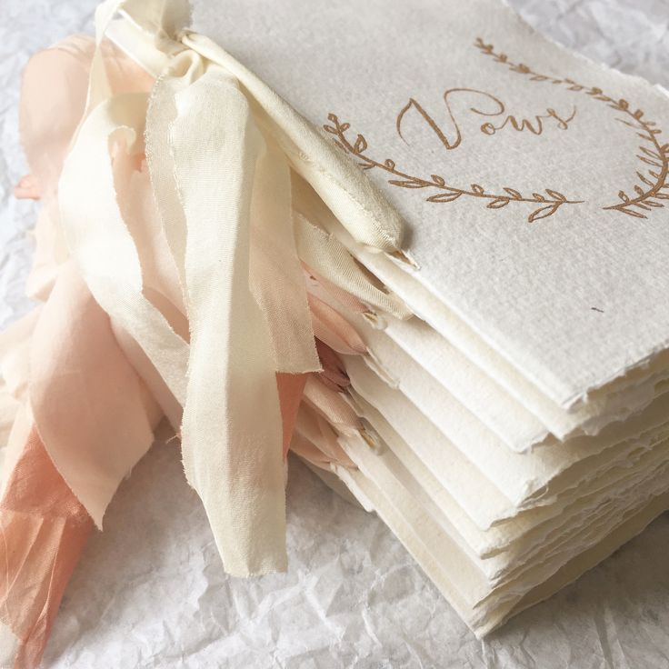 Vow booklets- handmade paper with gold calligraphy and silk ribbons