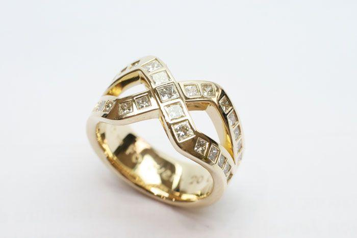 Fabulous mens cross-over design men's wedding ring with diamonds
