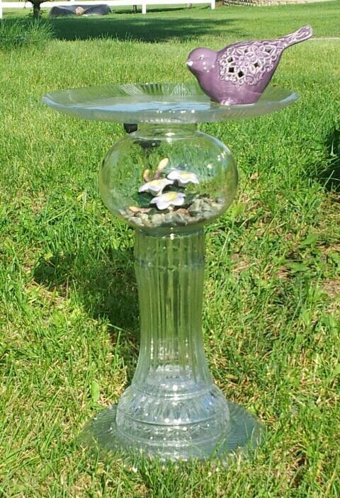 Repurposed glass bird feeder made by Laurie Flaherty