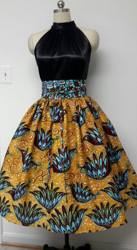 High-Waisted Fully lined Midi Skirt. Inside Pockets. Contrast. Obi Sash. Optional Separate Petticoat. Womens. Handmade. African Prints. (affiliate)