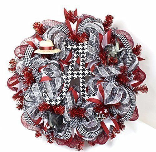 Alabama Crimson Tide Fan Deco Mesh Door Wreath. This Crazyboutdeco Deco Mesh Alabama Crimson Tide Fan Wreath is made with deluxe Crimson, Black and White deco mesh on a crimson metallic wreath,The wreath is trimmed with white and crimson ribbon and top off with a handpainted A that's sealed for weather protection. The Deco mesh wreath also features a Saban Hat, a Licensed Riddell Football helmet and top off with 2 Big AL Elephants with a gorgeous houndstooth ribbon to make it perfect for...