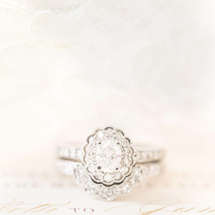 Oval diamond | Vintage style floral halo milgrain white gold setting | Photo by katelynjames.com