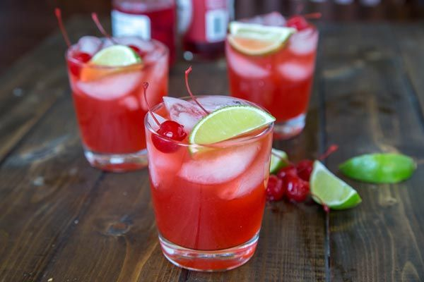 1 1/2 cups homemade limeade     1/4 cup cherry juice or grenadine     3 tablespoons triple sec     1/2 cup tequila     Maraschino cherri...