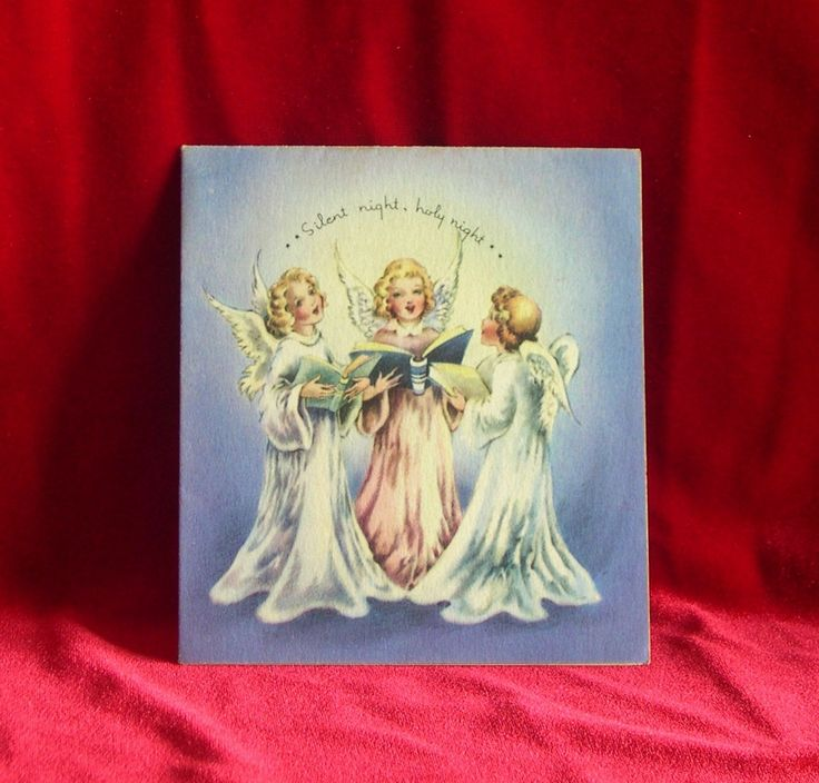 Beautiful 1942 caroling angels Christmas card from American Printing Company. From Yellow Dog Antiques on Etsy.  yellowdogantiques@etsy.com