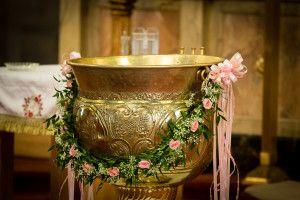 Greek Orthodox baptism - flowers on baptism font; Greek christening; girl baptism