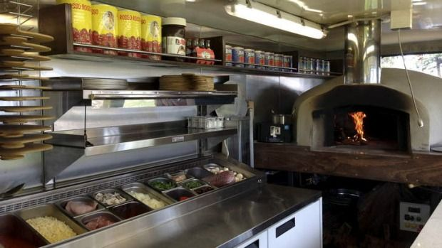 Michael Ibrahim has set up the Soul Kitchen Woodfired Pizza Truck, complete with a wood-fired pizza oven inside.