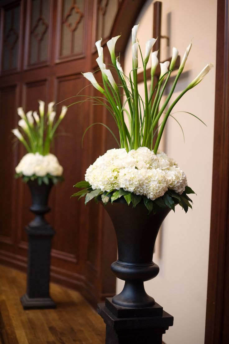 Altar Arrangement of white calla lilies and white hydrangea #dorothymcdanielsflowers #simplecolorphotography #birminghamflorist