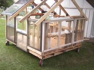 My husband and I are building a greenhouse out of old truck pallets, old house windows and scrap wood.  Very few newly purchased parts on it (like the wheels)