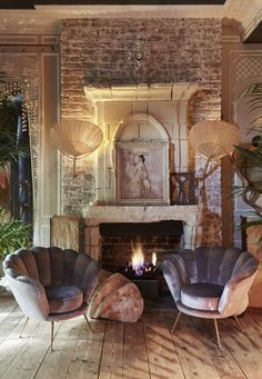These shell chairs are made even more glamourous by the use of the mink velvet.
