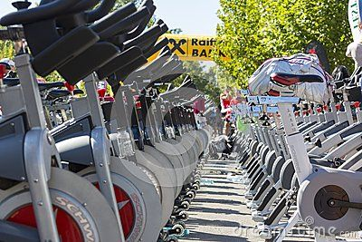Rows of over 200 aligned stationary spinning bikes during a public cycling event on September 15, 2013 in Bucharest, Romania. Low angle detail view between rows.
